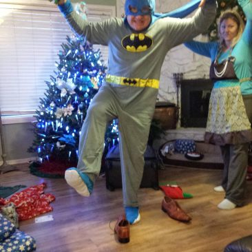 My dad made my mom hold his cape for his Christmas jammies pic